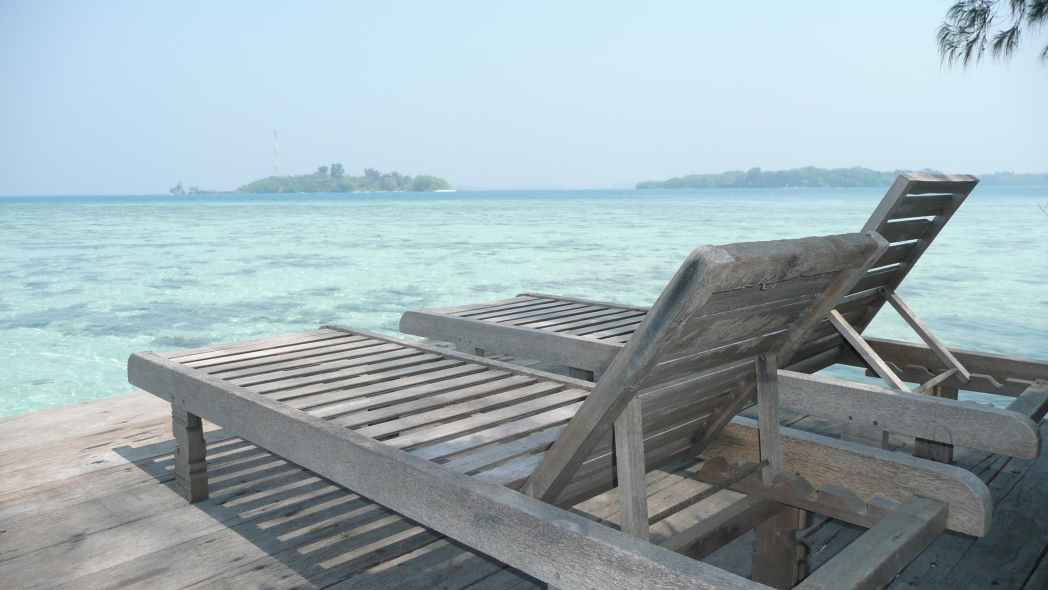View of sea with beach lounger