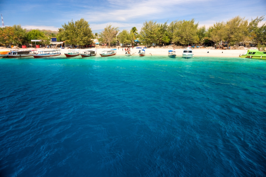 Clear water surrounded by light coloured sand in Gili.