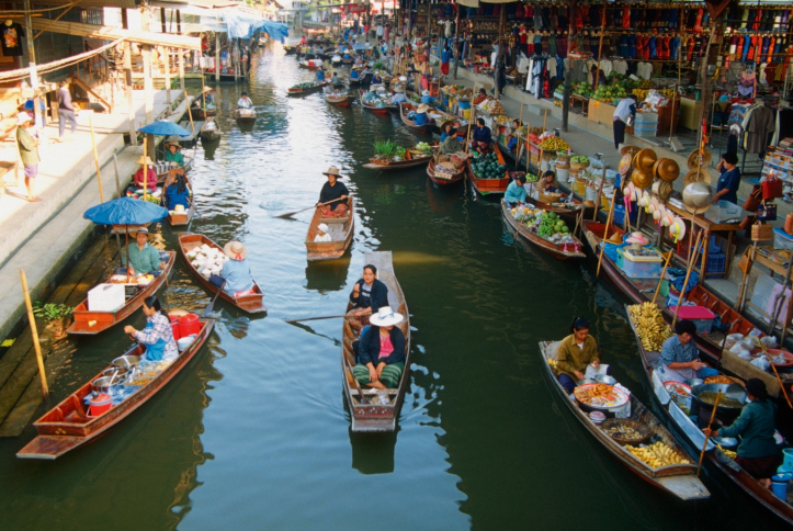 Vendors hawk their wares in boats within Bangkok's floating market.