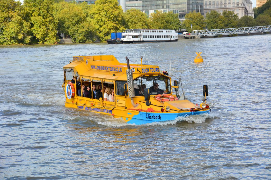 A London Duck Tour vehicle half submerged in the river
