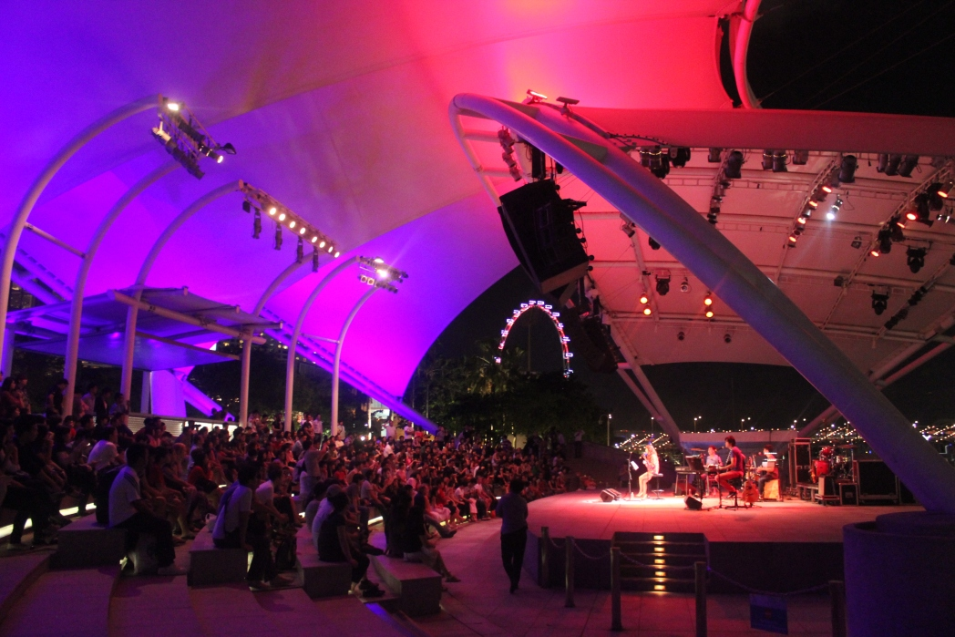 Hues of purple and pink set the stage for a free concert at the Esplanade's outdoor stage by the water