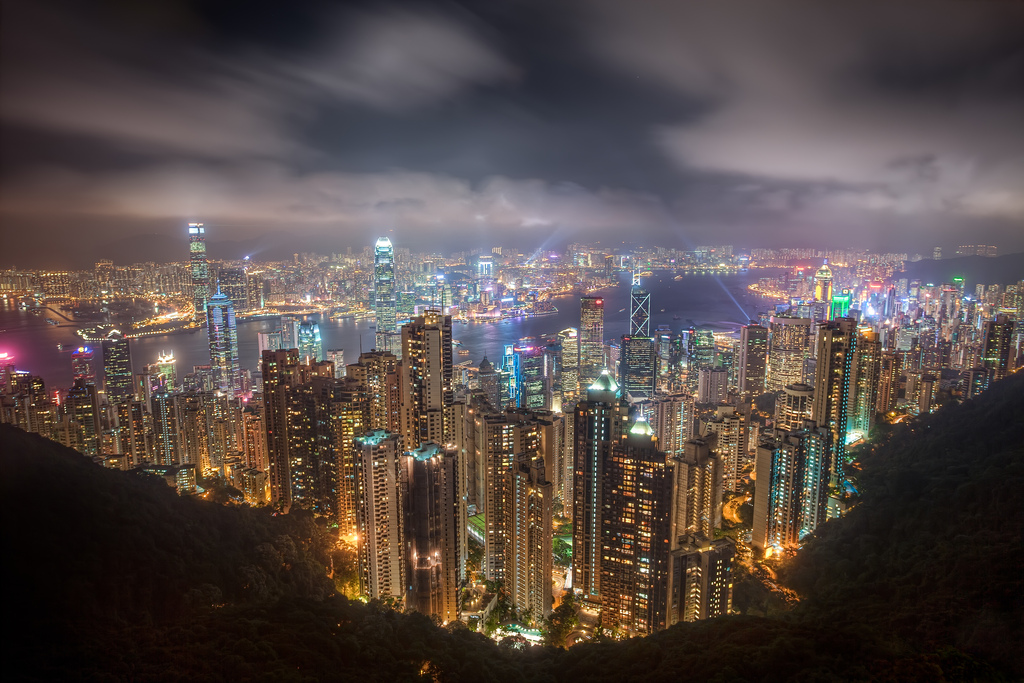 The cityscape of Hong Kong lit up with lights at night.