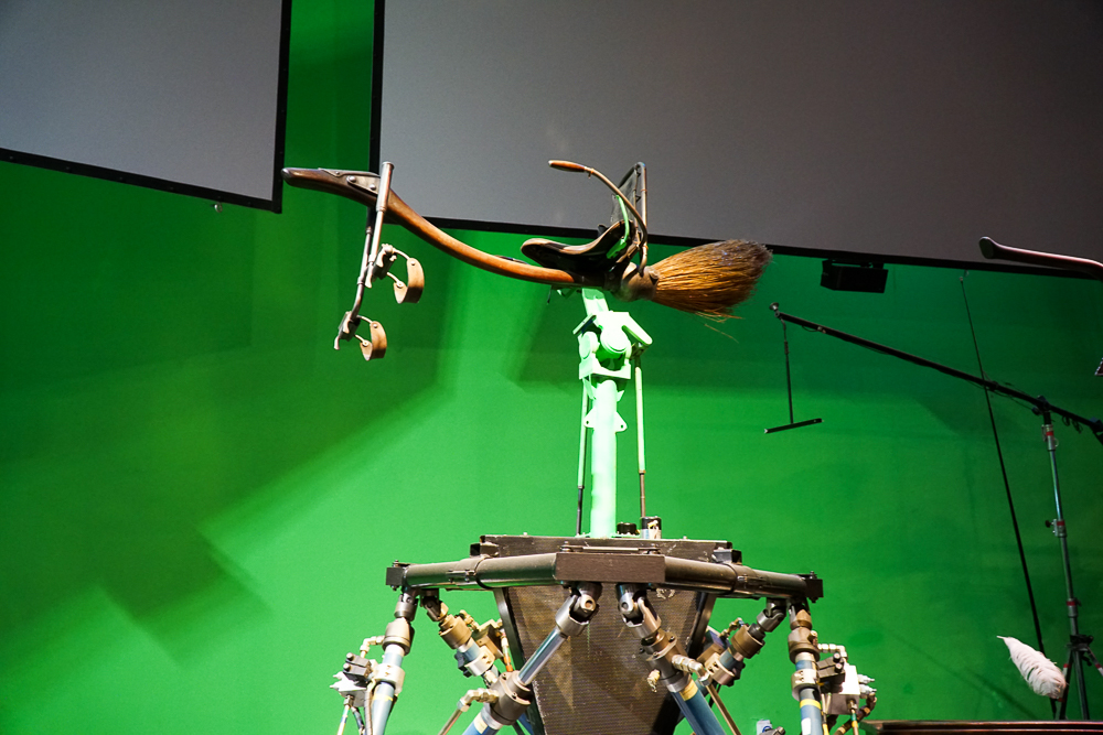 Green screen studio exhibit of Harry Potter flying broomstick scenes.