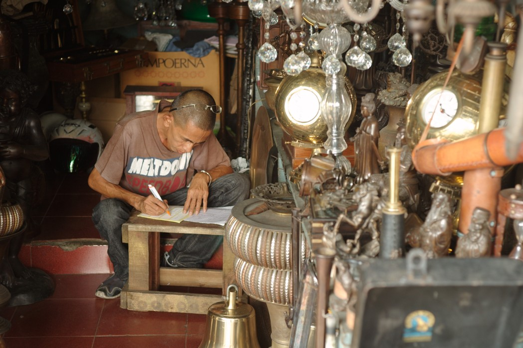 Man in Indonesian antique shop