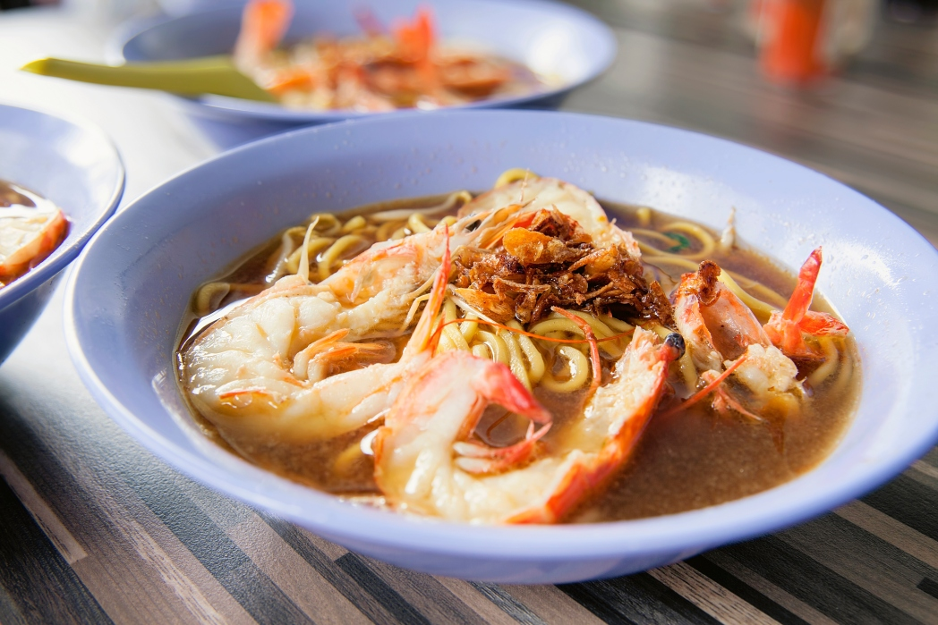 A steaming bowl of Singapore's prawn noodles.